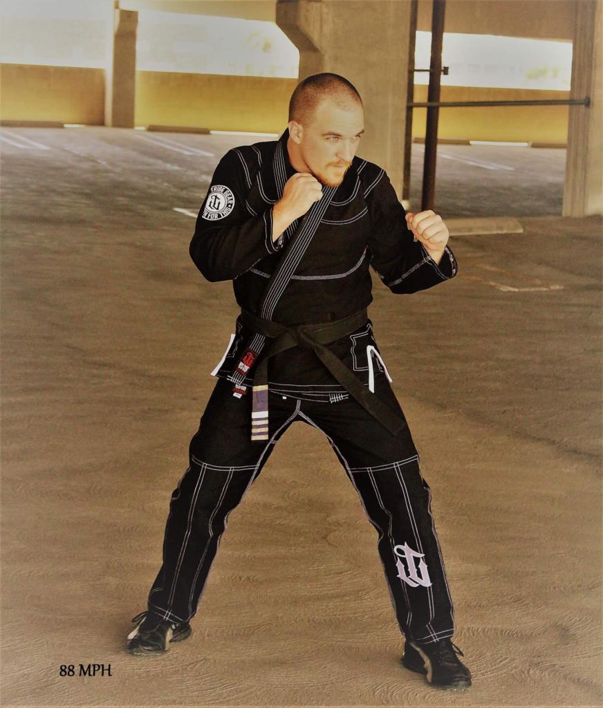 black gi boxing guard in parking garage